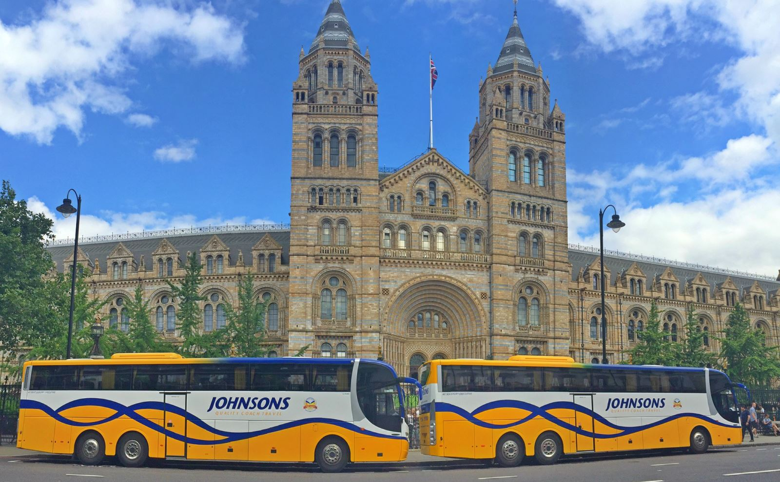 Johnsons Coaches outside National History Museum London
